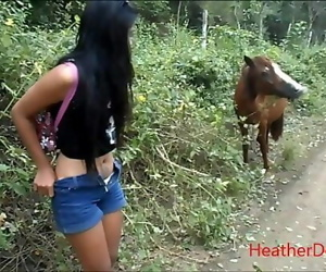 HD peeing next to horse in..